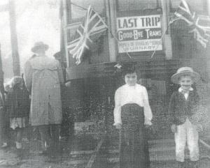 "Two children stand in front of the Burnaby Lake Interurban car, just prior to its last run through Burnaby in 1953. The boy has been identified as Grant Washington. A sign attached to the car reads: ""Last trip, good-bye trams, Pupils of Douglas School, Burnaby."" (Item 431-001, from the Burnaby Historical Society Community Archives Collection, courtesy of the City of Burnaby Archives.)"