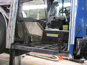 The front of the articulated bus being overhauled -- the floor panels have been completely stripped out.