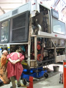 A Nova bus with left-rear damage, being repaired at Fleet Overhaul.