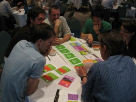 A group plays It's Your Move, the consultation exercise board game, during the 2010 10-Year Plan consultation last year.