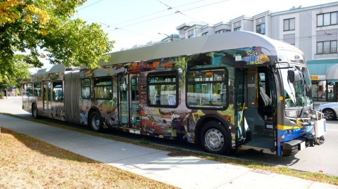 An articulated trolley on the 3 route, wrapped in a design by artist Germaine Koh for 88 BLOCKS, the Main Street public art program.