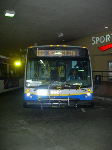 A Nova hybrid on the 130 route, parked at Metrotown Station loop. You can see the arched stanchions inside!