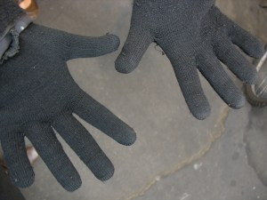 A cheap pair of stretchy gloves can keep your hands warm when cycling to work.