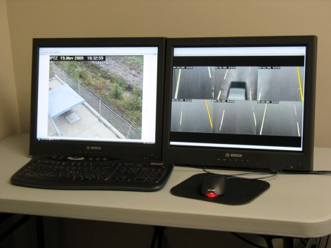 Two screens show video that is used in quality assurance checks.