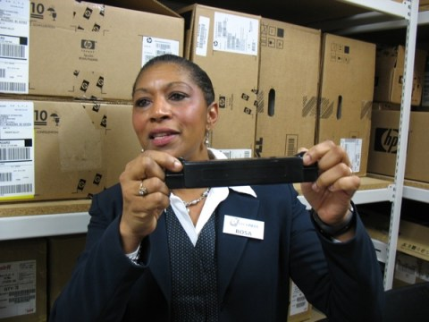 Rosa Rountree, CEO and general manager with Quickpass, shows what the external transponder looks like.