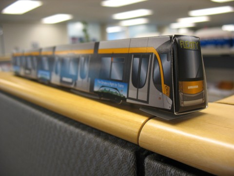 Oh yes - Bombardier gave out paper model streetcars! Here is mine atop my cubicle wall.