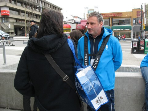 Transit host Marko helps out a customer at Broadway-City Hall.