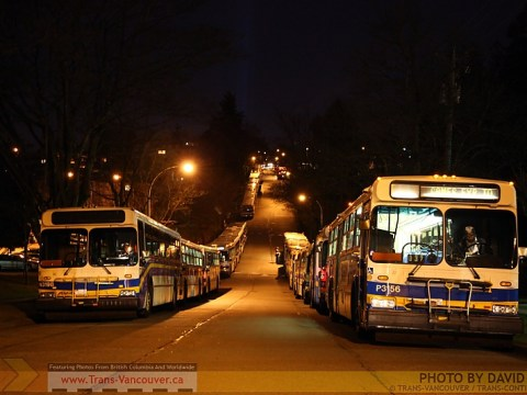 Extra Olympic buses parked on Pender Street, waiting to pick up crowds from the PNE.