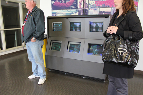 Monitors show the trains travelling on SkyTrain in the vestibule outside the SkyTrain control room.