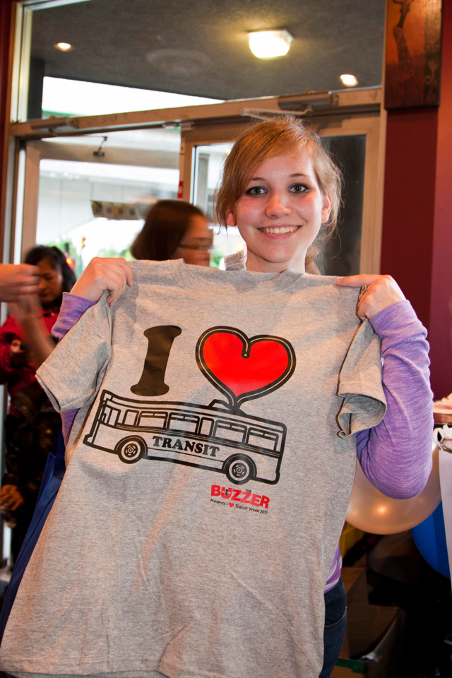 Another happy prize winner holding her special edition t-shirt