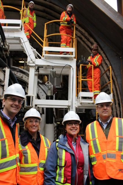"(From left to right) Minister Todd Stone, TransLink board chair Marcella Szel, Premier Christy Clark and XXX in front of, ""Alice"", the tunnel bording machine."