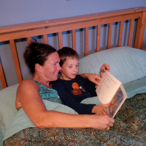 TL employee Cheryl reads to her son