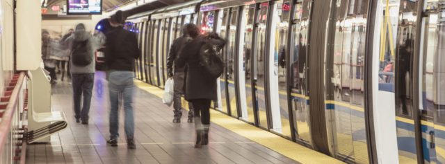 Customers disembark the SkyTrain