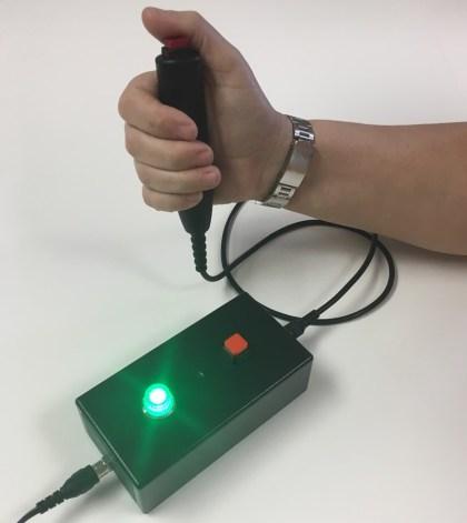 quiz box hand button press green light ECM400