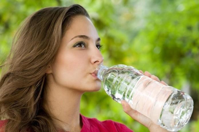 woman-drinking-bottle-water