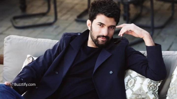 Engin Akyurek in black blazer and short hair