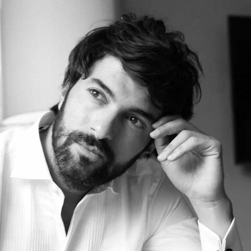Engin Akyurek in white shirt black and white turkish actor photo