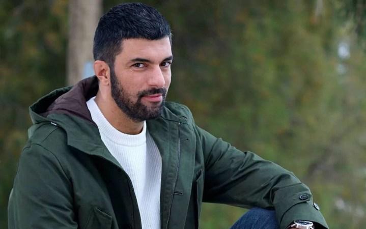 Engin Akyurek in white tee short hair turkish actor