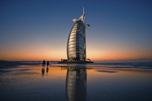 burj-al-arab-hotel-reflected-on-beach-at-sunset-dubai-united-arab-emirates-uae-1