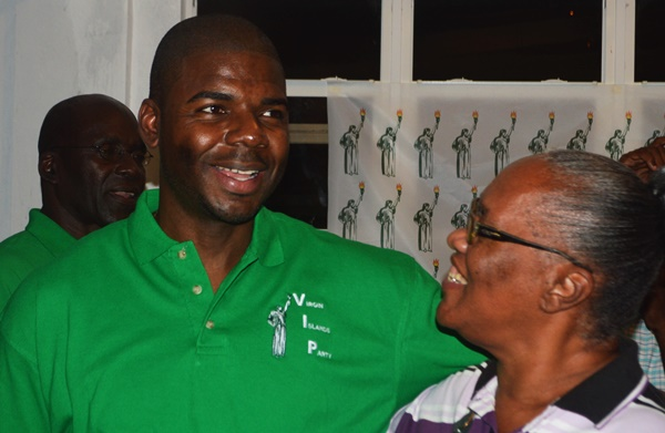 Dr Natalio 'Sowande' Wheatley greets a resident at the VIP Mix and Mingle event last evening