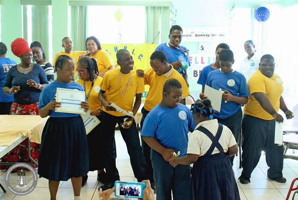 Blue and Gold House students from the Eslyn Henley Richiez Learning Centre celebrating after receiving awards for the fifth annual Spelling Bee and General Knowledge Quiz. (Photo Credit: GIS/Franklyn Skerritt)