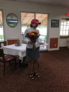 7/30/19 Tina club champ with flowers