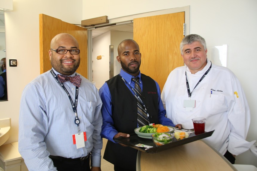 From left: Patrick Hubbard, Pierre Adelson, Food Services staff member, and Manar Alsebai, Food Services executive chef