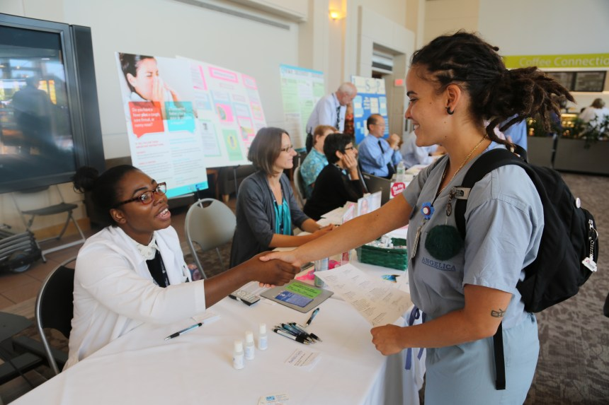 Laura Medina Martell (at right) meets Pharmacy student Oluwafeyisikemi Obatusin at the readiness fair.