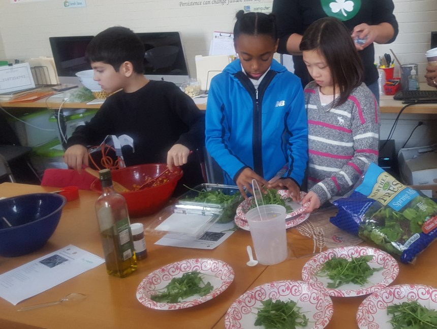 Local children learn to prepare healthy meals at All Dorchester Sports League, one of 14 organizations awarded Health Equity Grants from BWH.
