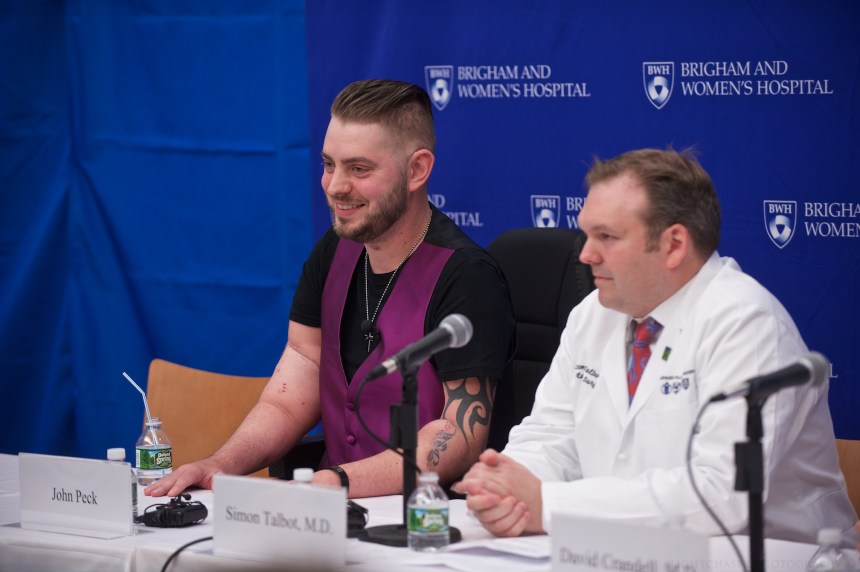 From left: Retired Marine Sgt. John Peck speaks at a press conference beside Simon Talbot.