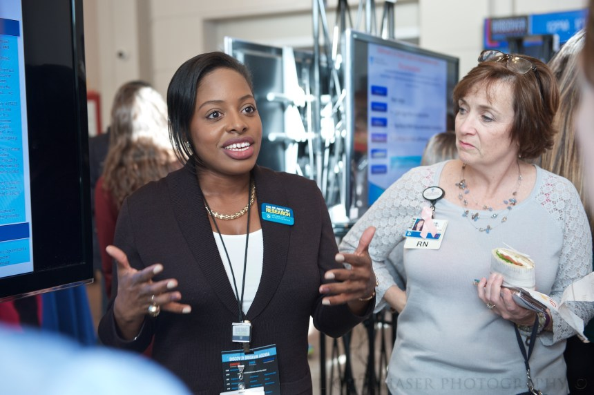 From left: Nurse-scientist Sasha DuBois discusses her research at Discover Brigham as Eileen O'Connell, nursing director, listens.