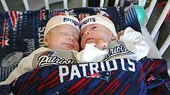 Benjamin and Samuel snuggle in their Patriots gear