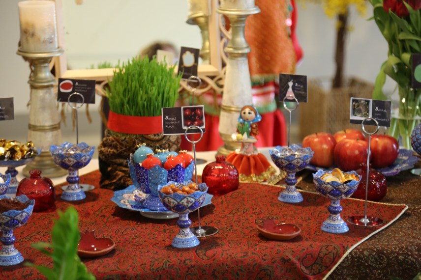 a Haft-sin table is adorned with symbolic items