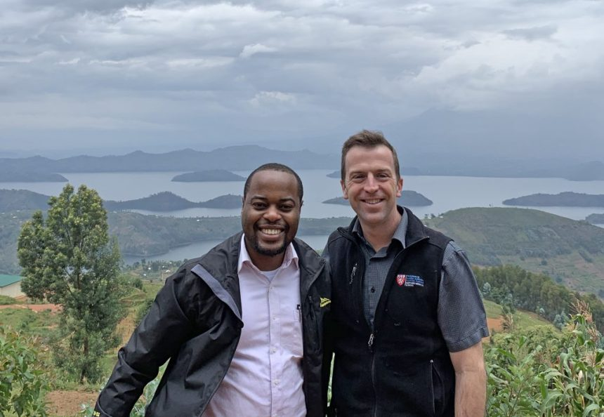 From left: Egide Abahuje and Robert Riviello stop for a photo in Butaro, Rwanda, after teaching courses in Kigali.