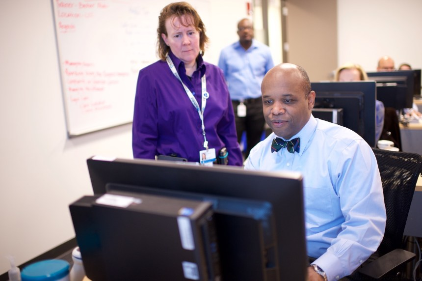 Amy Miller, MD, PhD, chief medical information officer for Inpatient Clinical Services, and O'Neil Britton, MD, chief health information officer for Partners, at a recent training session.