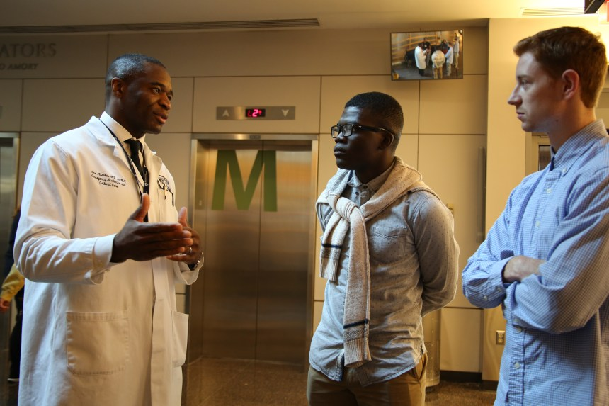 Imoigele Aisiku, MD, MBA, (left) speaks with undergraduate students from Worcester State University who visited BWH last summer.