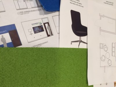 Mockup sketches and bright color swatches occupy most of the space on the desk of Brigham Innovation Hub (iHub) Executive Director Lesley Solomon