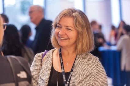Ursula Kaiser enjoys the post-symposium reception.