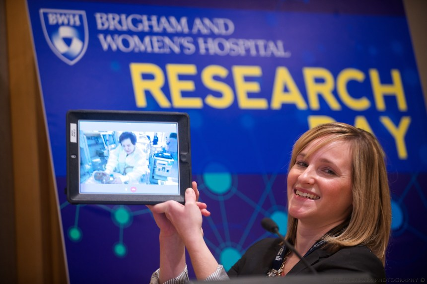 Stephanie Shine holds a tablet transmitting real-time video from the NICU using adapted Google Glass technology at last year's Research Day. Shine recently began a study to see if the technology may better connect moms and premature babies during their time in the NICU.