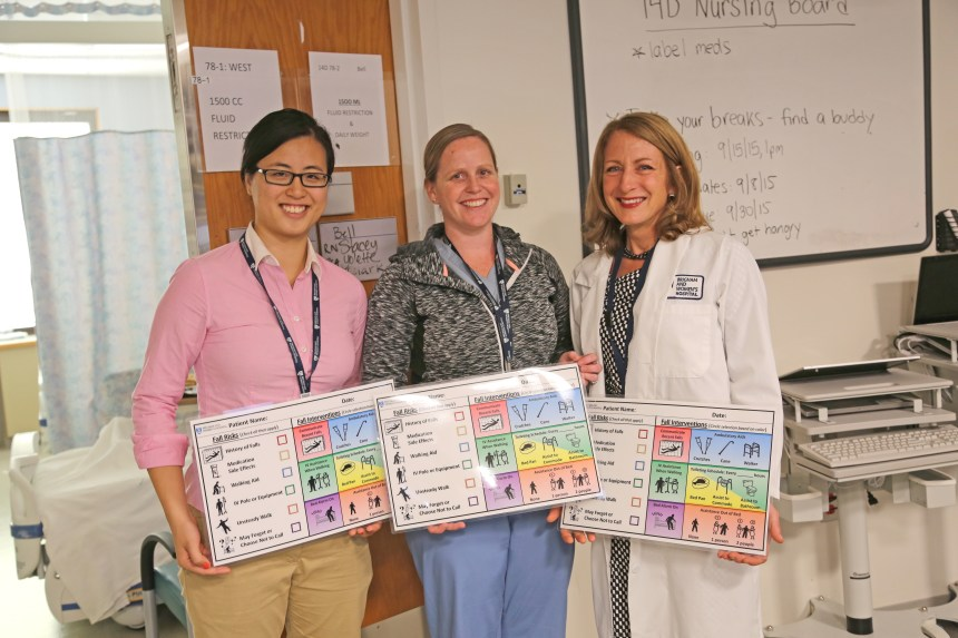 Left to right: Emily Leung, research assistant, Kathleen McIntosh, RN, nurse-in-charge, and Patricia Dykes, PhD, RN, FAAN, Haley nurse scientist, hold up the newly-designed patient-centered fall prevention plan used by nurses and patients.