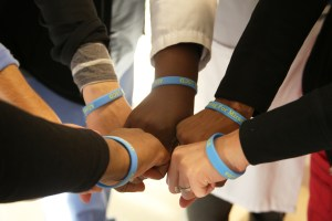 """Members of the 15CD clinical practice council show their """"Allowing for Miracles"""" bracelets."""