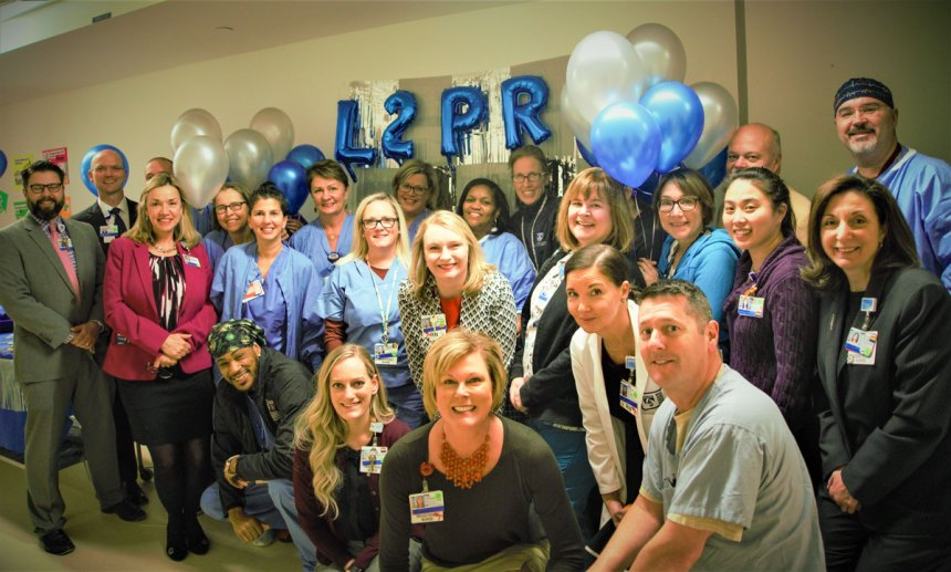 L2 PRU staff and Brigham leaders gather to celebrate the recovery area's new name.