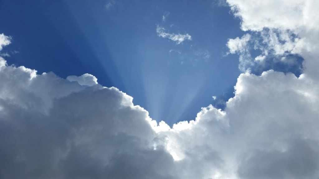 sunlight hiding behind cloud