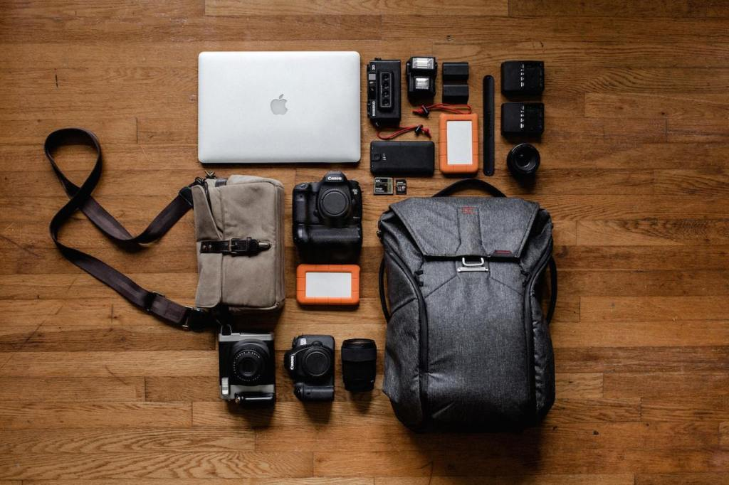 top-view-photo-of-laptop-near-camera-3178938