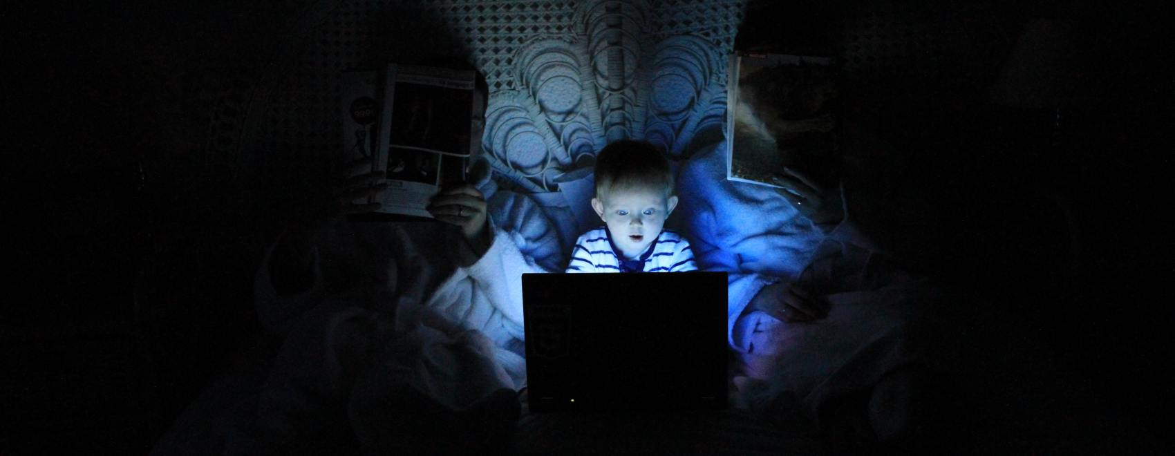 Child playing on laptop. Photo by Ludovic Toinel on Unsplash.