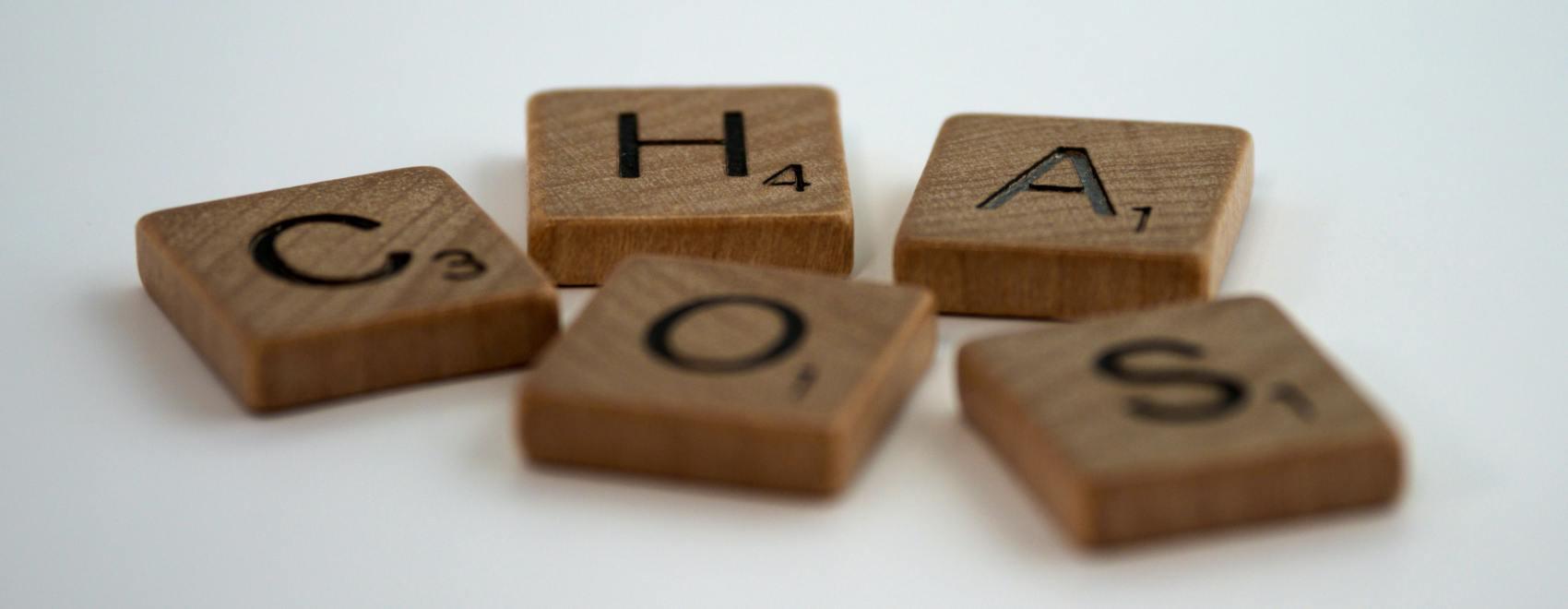 scrabble tiles spelling chaos