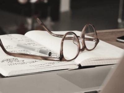 Glasses on book on desk