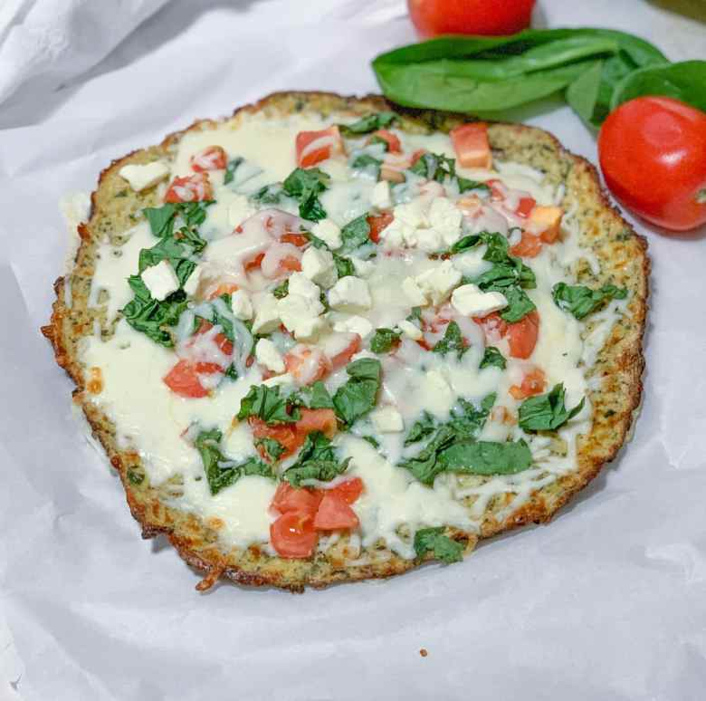 This cauliflower pizza crust is the best and you can top it with your favorite pizza ingredients for the tastiest low carb lunch or dinner option! #easy #recipe #low #carb #lowcarb #keto # healthy #vegetarian #veganrecipes #vegetables #cheese #ketogenicdiet #ketogenic
