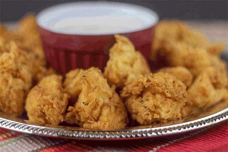 side view of copycat chick fil a nugget on a silver platter