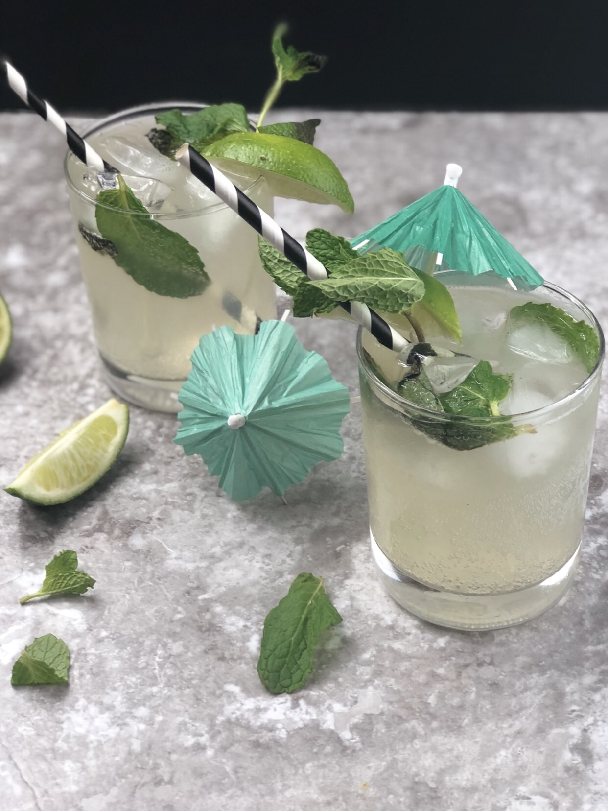 On those nice summer nights where an adult beverage sounds like it would hit the spot, whip up this vodka keto mojito which is a low carb cocktail. It is easy for people to not consider the sugar in drinks when they start watching carbs after starting a ketogenic diet. #ketomojito #vodkaketo #lowcarb #lowcarbcocktails #mojitorecipe #cocktail